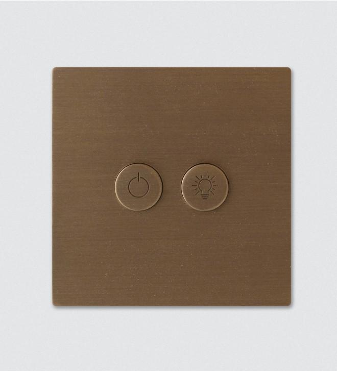 Plaques électriques en laiton avec boutons ronds